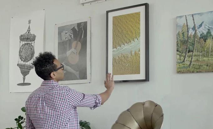 Hareketle kontrol edilebilen interaktif resim çerçevesi
